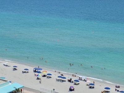 Photo for Beautiful beach front condo with a magnificent beach and pool view.