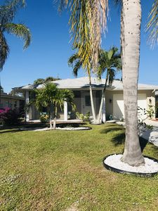 The front of our home with beautiful palm trees.