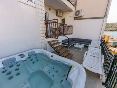 Photo for Seafront app with jacuzzi, 10 m from sea