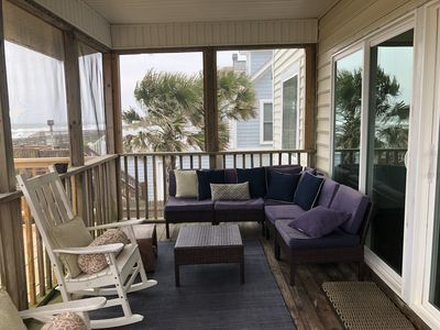 The screened porch overlooks the beach, and is a great respite from the sun.