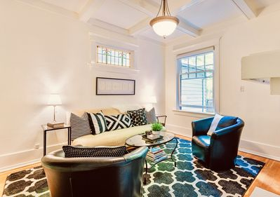 Living room with original high tray ceiling