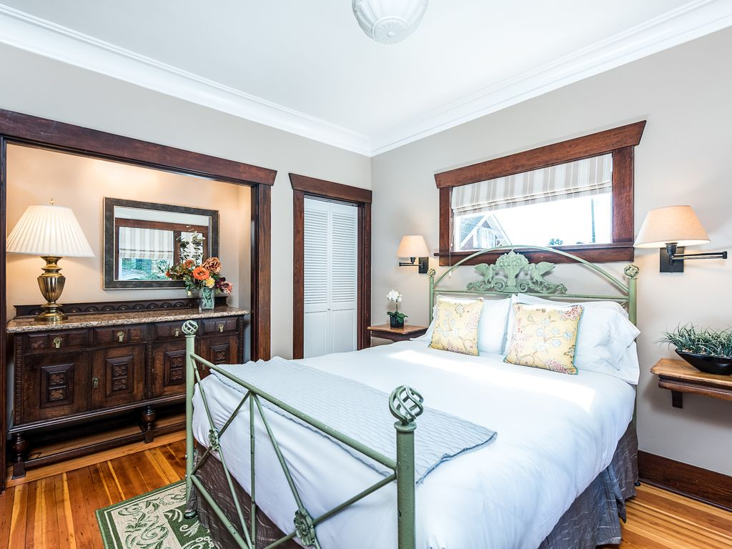 warm by fireplace in unique historic queen vrbo