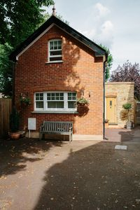 Photo for Renovated detached 2 bedroom coach house in Claygate Surrey
