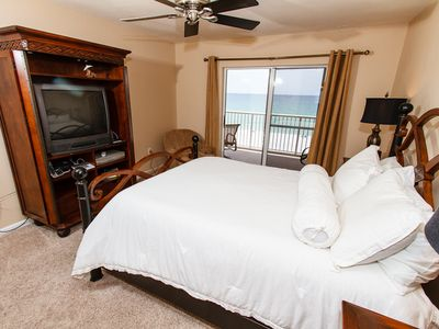 """Master Bedroom - Master bedroom with access to the units private balcony. Now with a new 42"""" LED TV"""