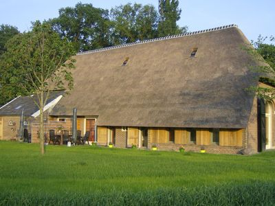 Photo for Staying in a thatched barn with box bed, beautiful view, region Achterhoek