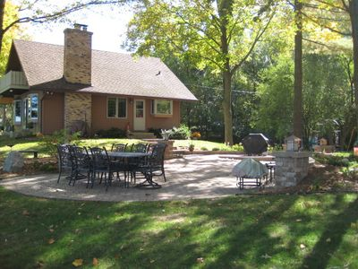 Large patio with a table for 8, bbq, and fire pit for unlimited entertainment.