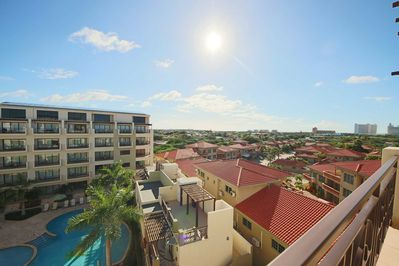 Sit on your balcony and enjoy your amazing pool and island view!