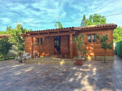 Photo for Beautiful Wooden Cottage with Pool, Air Conditioning & Spacious Terrace; Parking Available