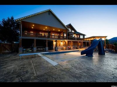Photo for Family Reunion Home with Pool and Golf Simulator