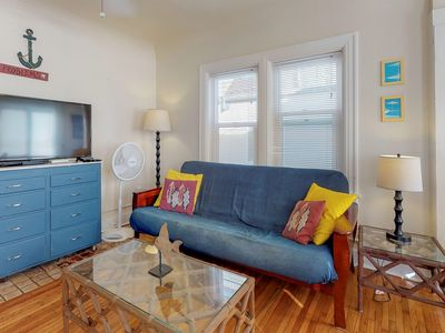 Photo for Third-floor condo steps from beach - comes w/ boogie boards!