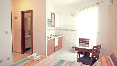 Photo for Studio apartment with balcony 130m from beach