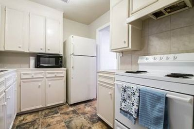 Kitchen has a microwave, refrigerator, stove for cooking and coffee pot!