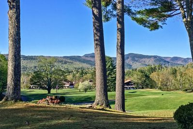 This Glen condo is located on a golf course across the street from Story Land!