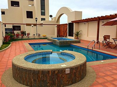 An adult pool, children's pool and jacuzzi
