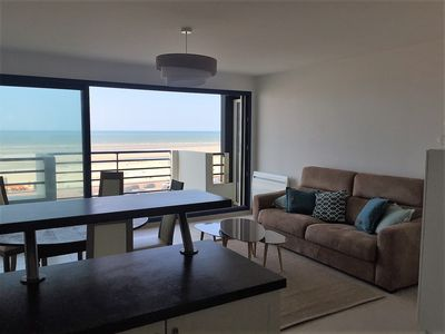 Photo for Beachfront, bright and spacious apartment