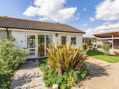 Photo for Comfy single-storey cottage which puts you very close to the Country Club