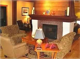 Cozy Club Room with fireplace and wet bar, perfect for entertaining guests.