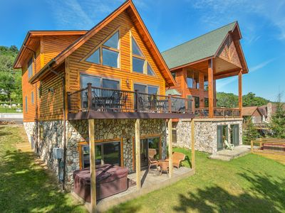 Stunning log home that offers a phenomenal lake front!
