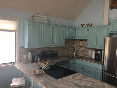 Recently updated kitchen with granite countertops and stainless steel appliances