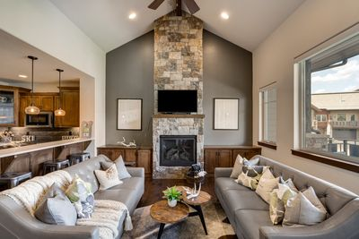 Main floor family room with floor to ceiling stone fireplace