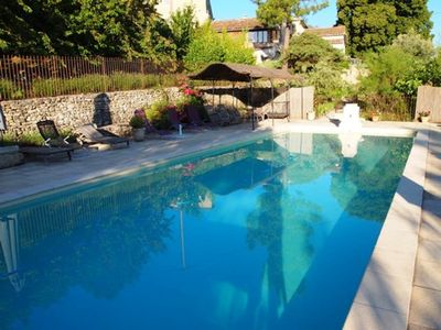 Photo for Homerez last minute deal - Amazing house with shared pool