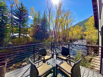 Photo for 360º Tour! Gorgeous duplex, direct riverfront, deck, fireplace, Up to 45% OFF!