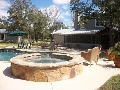 Hot tub has waterfall feature into pool