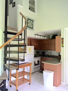 Kitchen and circular stairs to upstairs bedroom