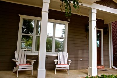 Beautiful porch seating with Adirondack chairs