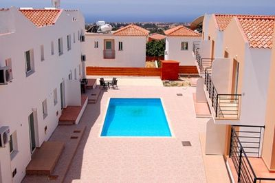 large inviting swimming pool and direct sea views