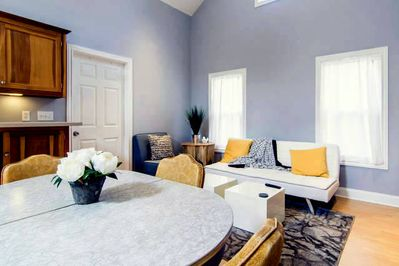 Comfortable furnishings, cool colors, modern decor.