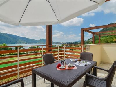 Photo for Dolcevita apartment in Lago d'Iseo with WiFi, private parking & private roof terrace.