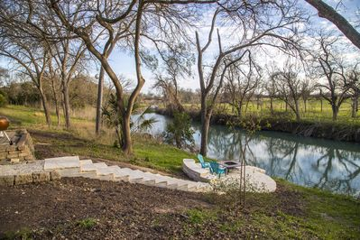 backyard limestone deack and river view