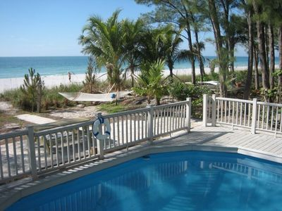 Photo for BEACHFRONT TOWNHOME DIRECTLY LOCATED ON THE SAND WITH STUNNING SUNSET VIEWS