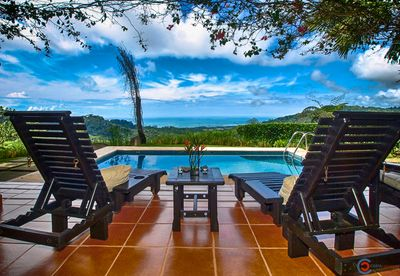 Stunning ocean and mountain view from your own poolside chairs!