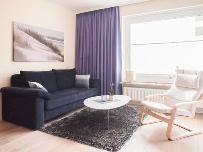 Photo for Sunny comfort apartment with 2 bedrooms and partial lake view just a few steps from the beach, WiFi, elevator, parking, indoor pool and sauna!