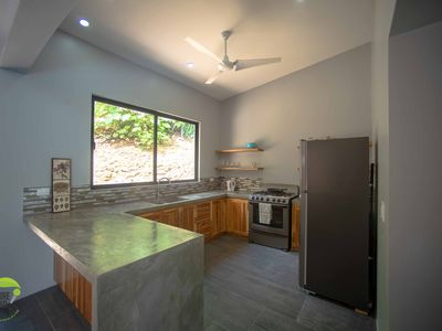 Photo for Stunning new modern home in the Jungle 5 minutes from white sandy beaches