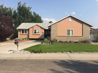 Photo for Modern, well decorated, landscaped, by the river 4 bedroom homr