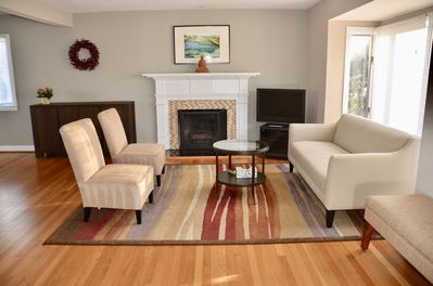 Bright and open living room, furnished with new furniture and original art work