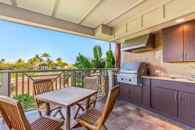 Lanai with outdoor kitchen and gas grill, view of lake and golf course