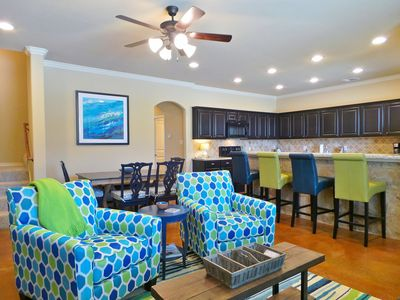 The open floor plan features a living room, dining area, and kitchen!
