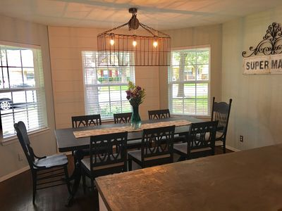 Spacious dining area for 8, perfect for dining or playing a game on hand!