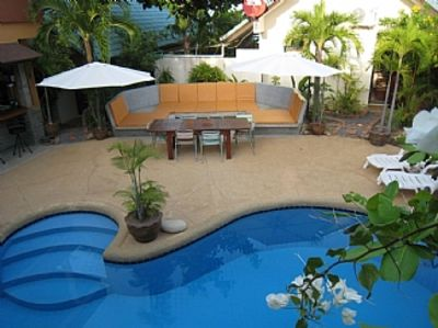 Photo for tropical oasis in a sought after location with private pool , bar and spa  ,