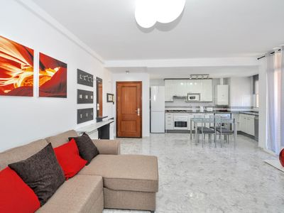 Photo for Modern apartment with terrace, air conditioning, barbecue, shared pool
