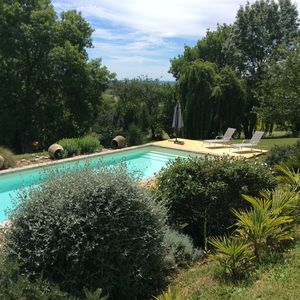 Photo for Charming cottage, overlooking the countryside, pool and Pyrenees