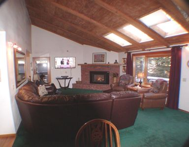 Living Room with 55' TV, Bay window and skylights.  27' x 16'