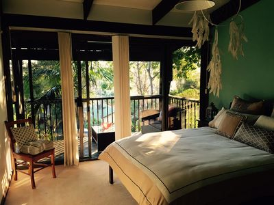 The main bedroom, own balcony, stunning lake views, built in robes