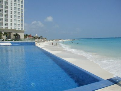 OUR INFINITY SWIMMING POOL PRACTICALLY MELTS INTO THE BEACH AND OCEAN.