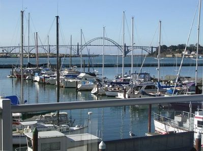 View from deck - marina, Yaquina Bay, sliver of ocean