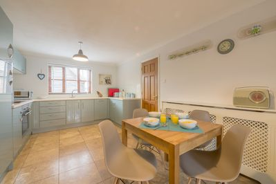 Ground floor:  Kitchen with oak table and seating for four